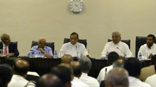 Speaker Karu Jayasuriya (C) has summoned parliament to meet on Wednesday in defiance of the president