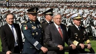 President Andres Manuel Lopez Obrador (C) and his top military brass review members of Mexico's new security force, the National Guard