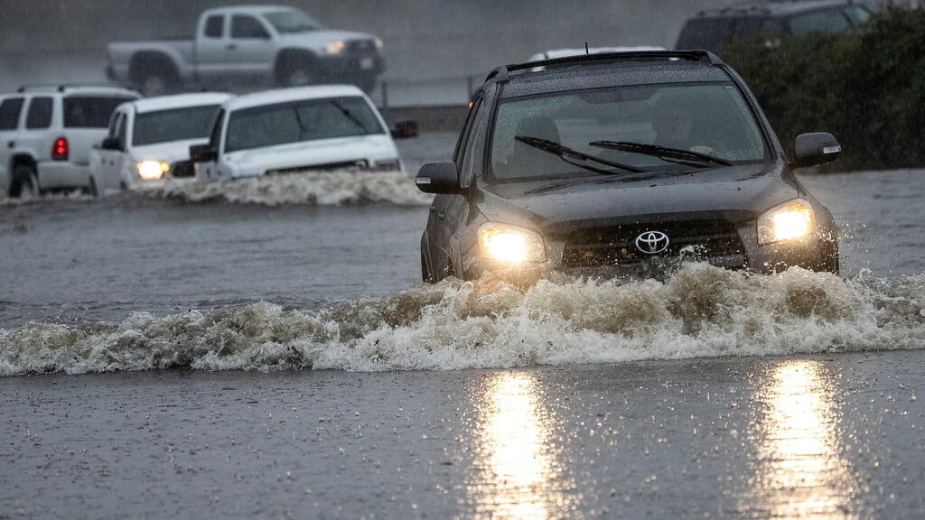 Powerful storm in California triggers mudslides, flooding and power outages