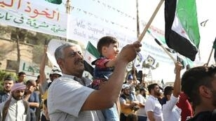 Bahr Nahhas attends a demonstration in the rebel-held town of Maaret al-Numan, in the north of Idlib province on October 19, 2018