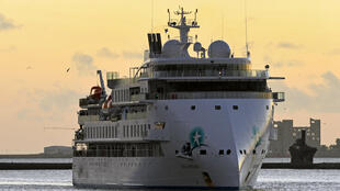 Coronavirus-hit cruise liner, the Greg Mortimer, arrives in the port of Montevideo after the government of Uruguay allowed it to disembark passengers on April 10, 2020