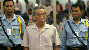 Former Khmer Rouge S-21 prison chief Kaing Guek Eav, better known as Duch, stands in a courtroom during a pre-trial in Phnom Penh, Dec. 5, 2008.