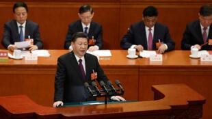 Le président chinois Xi Jinping devant le Parlement, mardi 20 mars.