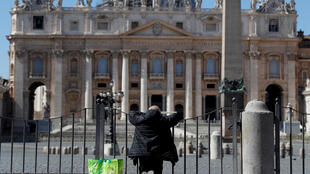 A man prays in front of an empty St. Peter's Square as the spread of the coronavirus disease continues in Rome, Italy, March 25, 2020.