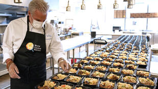 Le Bernardin chef and co-owner Eric Ripert prepares meals for health care workers as part of the World Central Kitchen charity at his flagship New York restaurant in New York City on May 6, 2020.