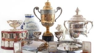 Some of the trophies up for grabs include a replica of a Challenge Cup and the three-quarter size replica of the Renshaw Cup presented after he became the youngest ever Grand Slam singles champion
