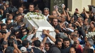 In this file photo taken on November 3, 2018, Coptic Christians carry the coffin of a victim killed in a jihadist attack a day earlier in Egypt's Minya province