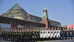 Soldiers from China's People's Liberation Army march on Red Square in Moscow during a June 2020 parade to mark the 75th anniversary of the Soviet victory over Nazi Germany, amid US pressure for both Russia and China to join nuclear arms talks