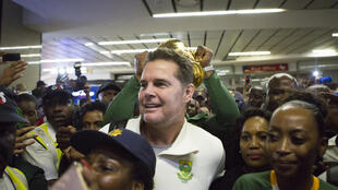 Springbok supporters greet Rassie Erasmus (C) in Johannesburg last November after South Africa won the Rugby World Cup in Japan.