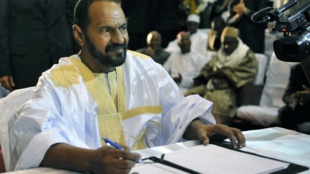 In this file photo taken on June 20, 2015, Sidi Brahim Ould Sidati, a member of the Arab Movement of Azawad, signs the amended version of the Algerian Accord on behalf of the Coordination of Azawad Movements (CMA) in Bamako.