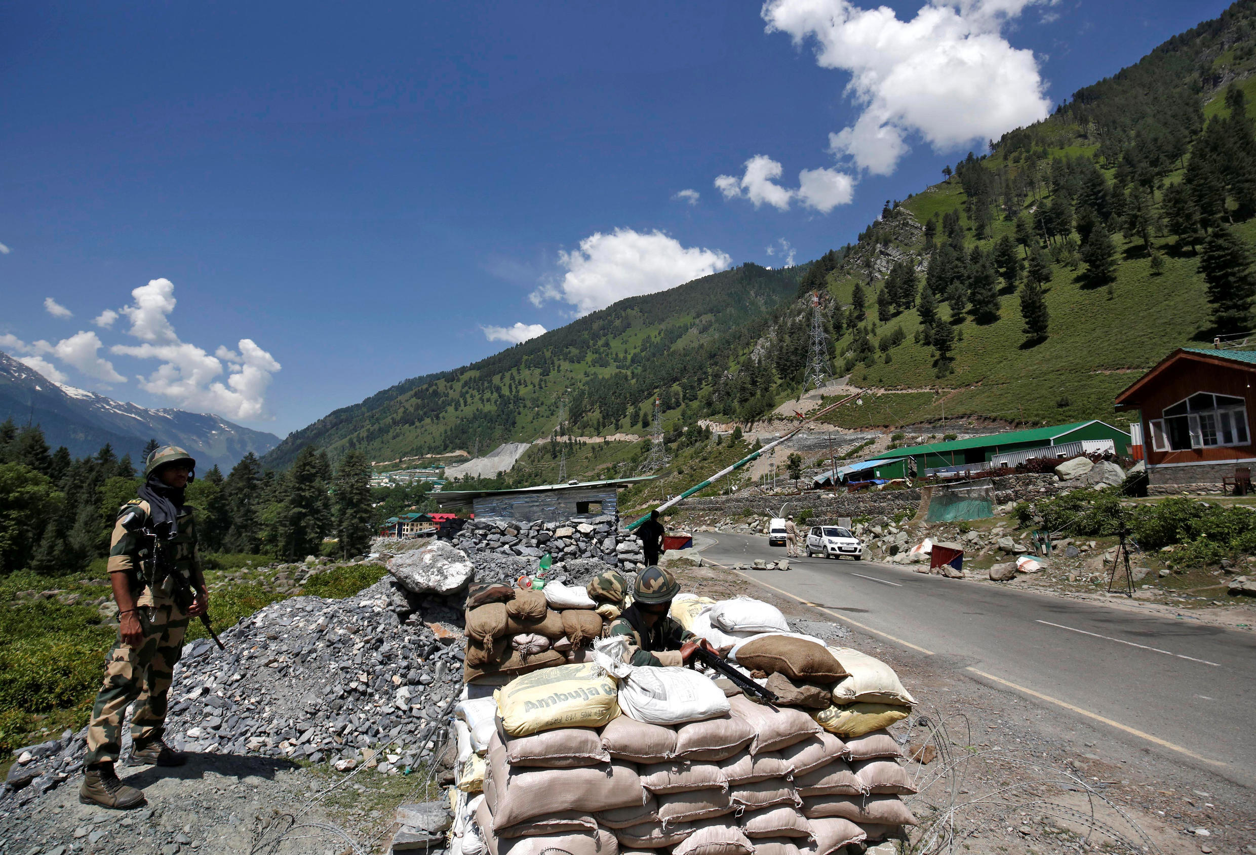 India's Border Security Force (BSF) soldiers stand guard at a checkpoint along a highway leading to Ladakah, at Gagangeer in Kashmir's Ganderbal district June 17, 2020.