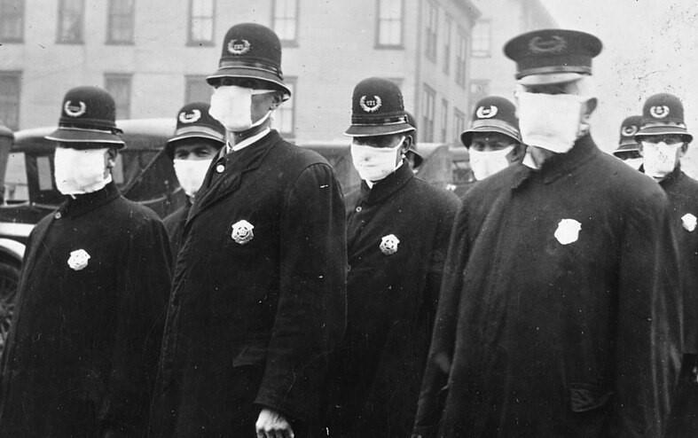 Police officers in Seattle, USA wearing face masks towards the end of the infamous second wave of the Spanish flu in December, 1918.
