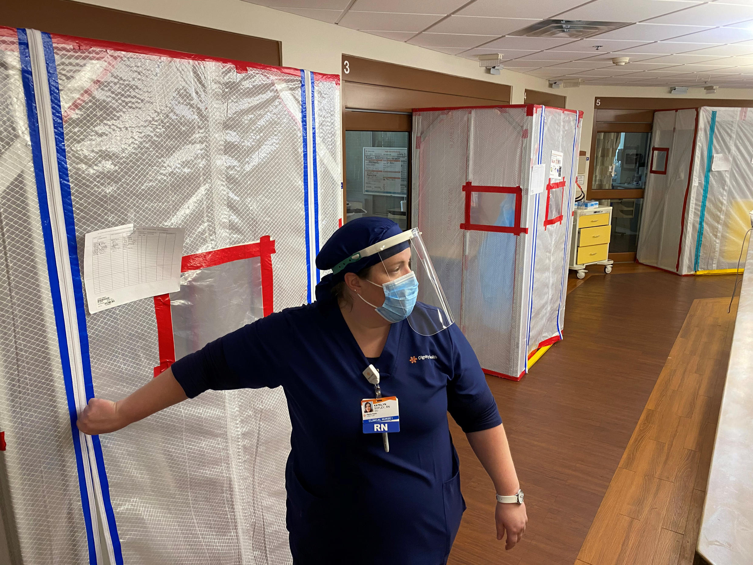 Nurse Katelyn Sofley stands at the entrance to a negative pressure ICU hospital room, where Covid-19 patients are treated, at St John's Regional Medical Center in Oxnard, California, U.S., July 9, 2020.