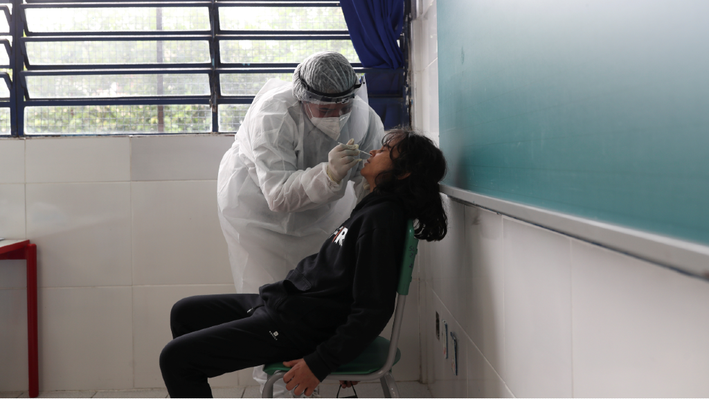A health worker performs a CRP test on student Theo Barbosa Rodrigues at the Almir Pereira Bahia Reverendo state school in Taboao da Serra, on the outskirts of Sao Paulo, Brazil, October 15, 2020.
