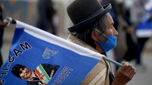 Evo Morales -- whose image is seen here on a supporter's flag during a campaign rally on September 9, 2020 in El Alto, Bolivia -- remains a hugely influential figure in the South American country