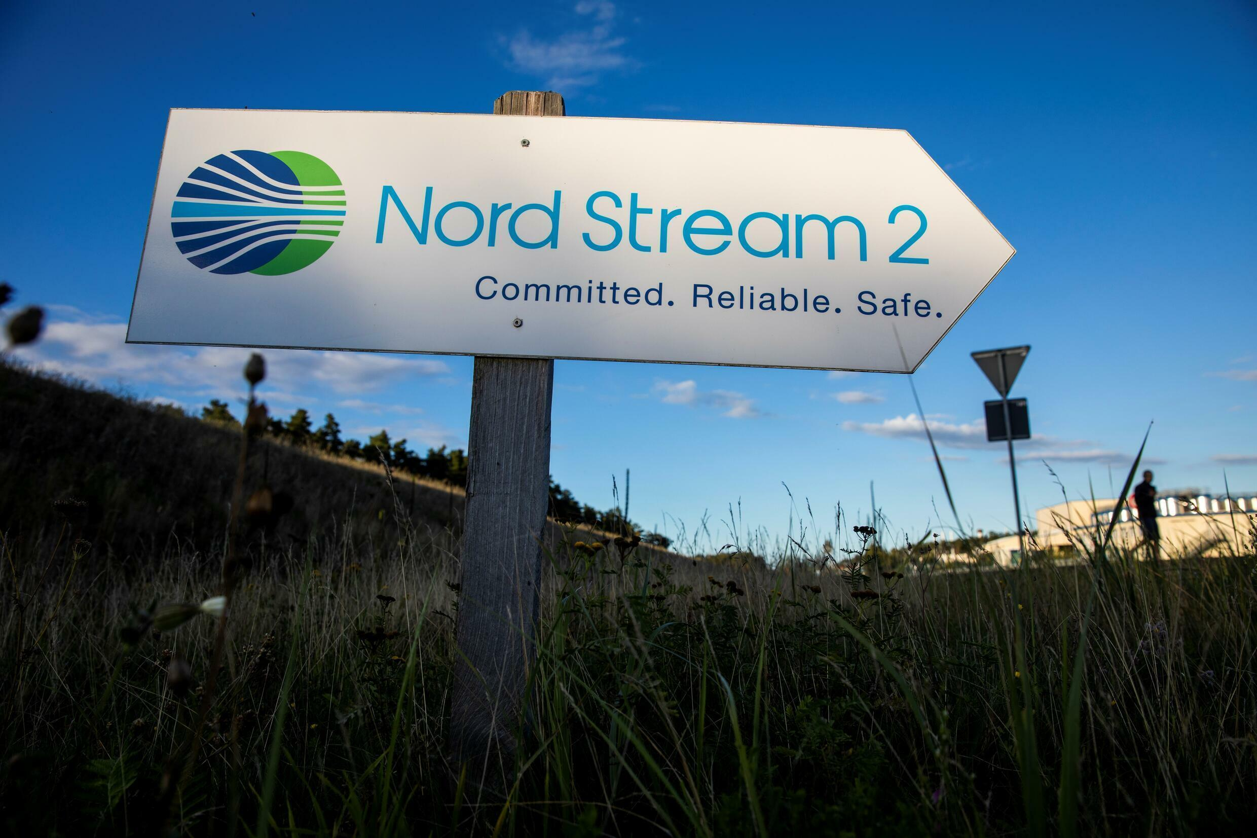 A road sign directs traffic towards the Nord Stream 2 gas line landfall facility entrance in Lubmin, north eastern Germany, in 2020