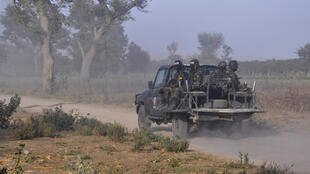 Members of the Cameroonian Rapid Intervention Force patrol the outskirts of Mosogo in the far north region of the country on March 21, 2019. Boko Haram jihadists have been active in the area since 2014.