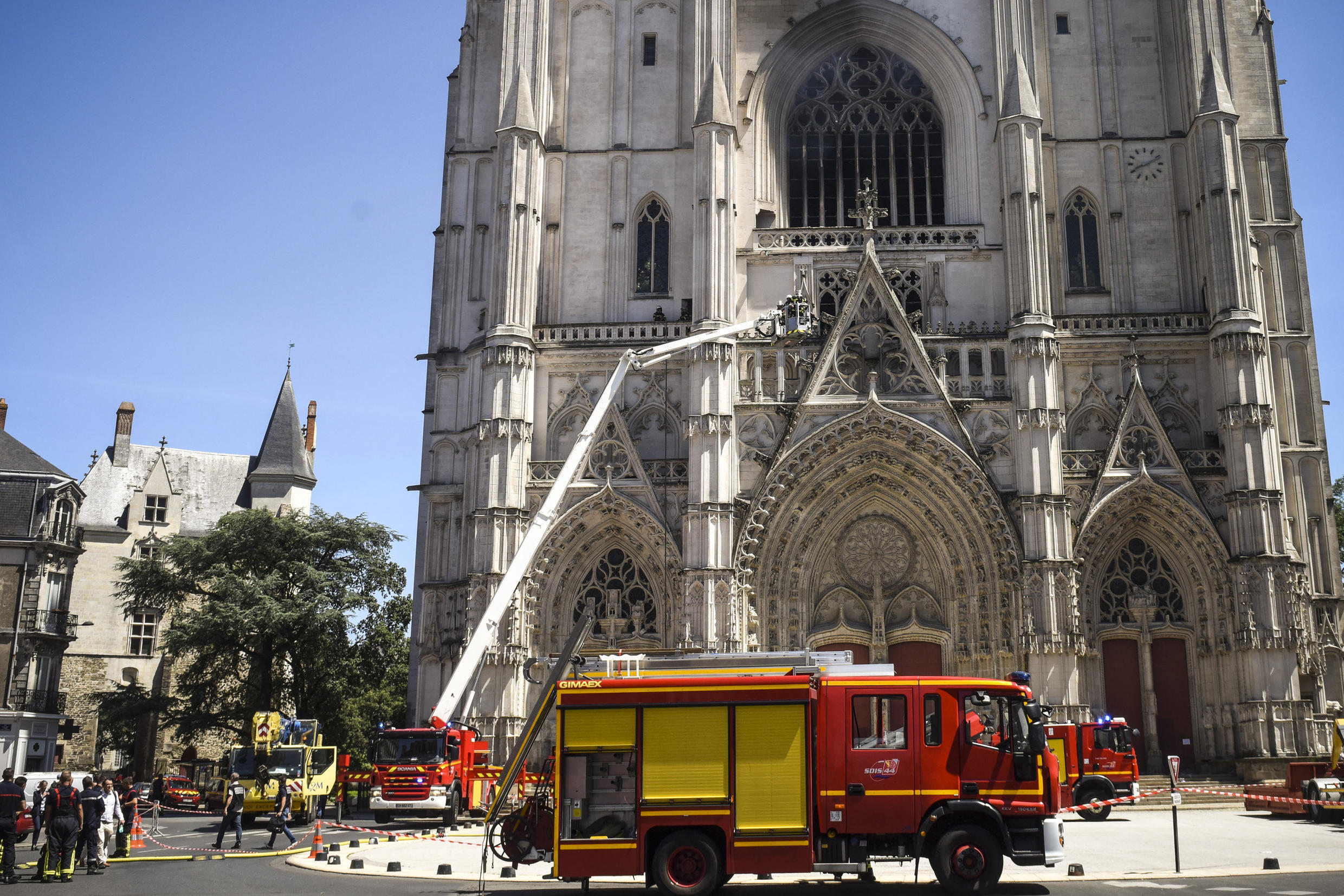 Firefighters are at work at the Cathedral of St Peter and St Paul in Nantes on July 18, 2020 after a fire ravaged parts of the Gothic building before being brought under control, sparking an arson investigation and leaving Catholic officials lamenting the loss of priceless historical artefacts.