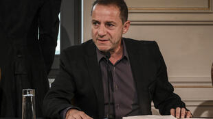 Dimitris Lignadis, a renowned actor and director, faces accusations of serial rape and indecent assault, according to an arrest warrant