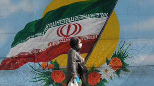 An Iranian woman wears a face mask in the capital Tehran