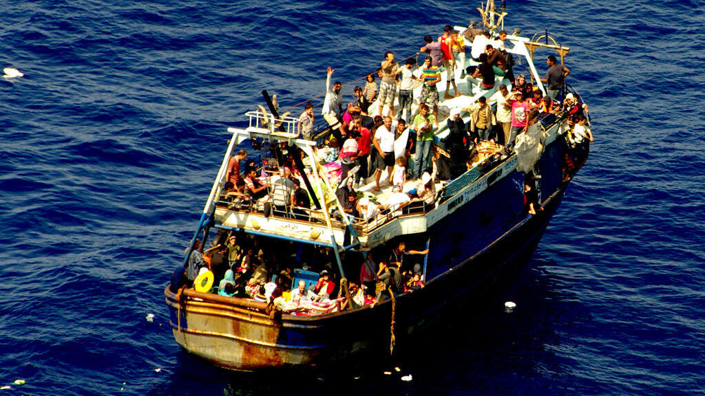 Embarcation de migrants le 4 octobre 2014.