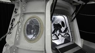 SpaceX will use its Falcon 9 rocket to launch its Crew Dragon capsule - simulator pictured here - to the orbiting International Space Station