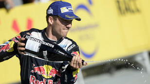 Sébastien Ogier, cinq fois champion du monde de rallye, célébrait sa deuxième place au rallye de Catalogne, le 8 octobre à Salou.