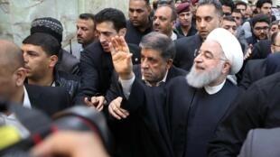 الرئيس الإيراني حسن روحاني خلال زيارته لمدينة النجف العراقية - 13 مارس/آذار 2019