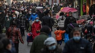 The new normal in Wuhan is much like the old reality; cars buzz down highways, sidewalks bustle with shoppers and public transport is busy