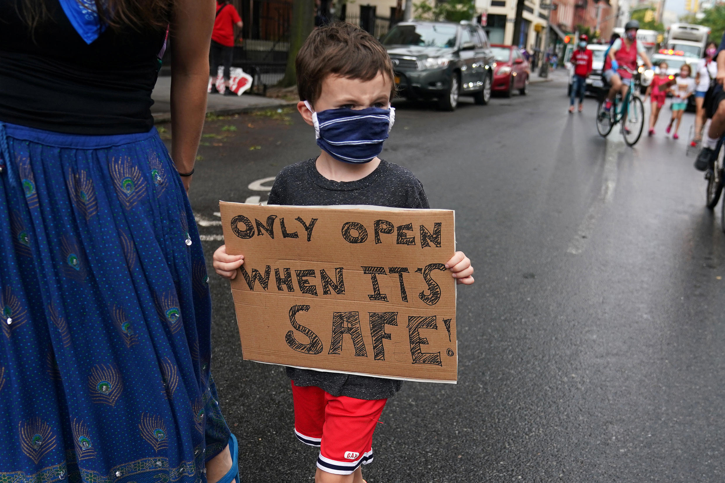 A child marches down Court St to protest the opening of schools following the outbreak of the coronavirus disease (Covid-19) in the Brooklyn borough of New York City, New York, US, September 1, 2020.