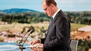 French PM Jean Castex reads a document before appearing on French TV channel TF1 in Paris, July 21, 2021.