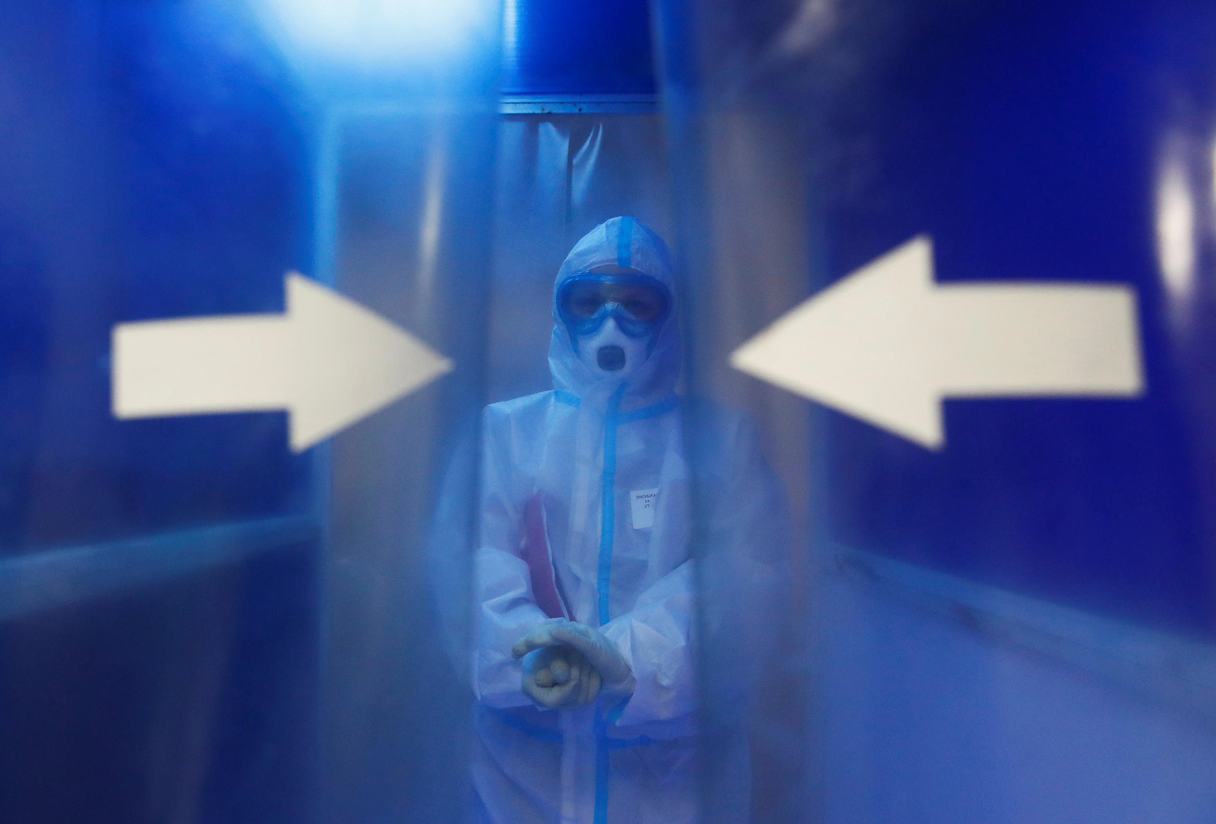 A medical specialist wearing personal protective equipment (PPE) walks through a disinfection chamber at the City Clinical Hospital Number 15 named after O. Filatov, which delivers treatment to patients infected with the coronavirus disease (COVID-19), in Moscow, Russia May 25, 2020.