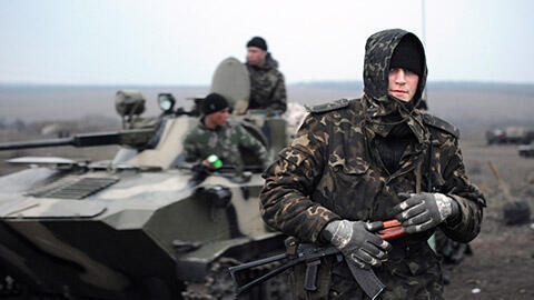 A Ukrainian soldier on patrol 60 kilometres from the Russian border