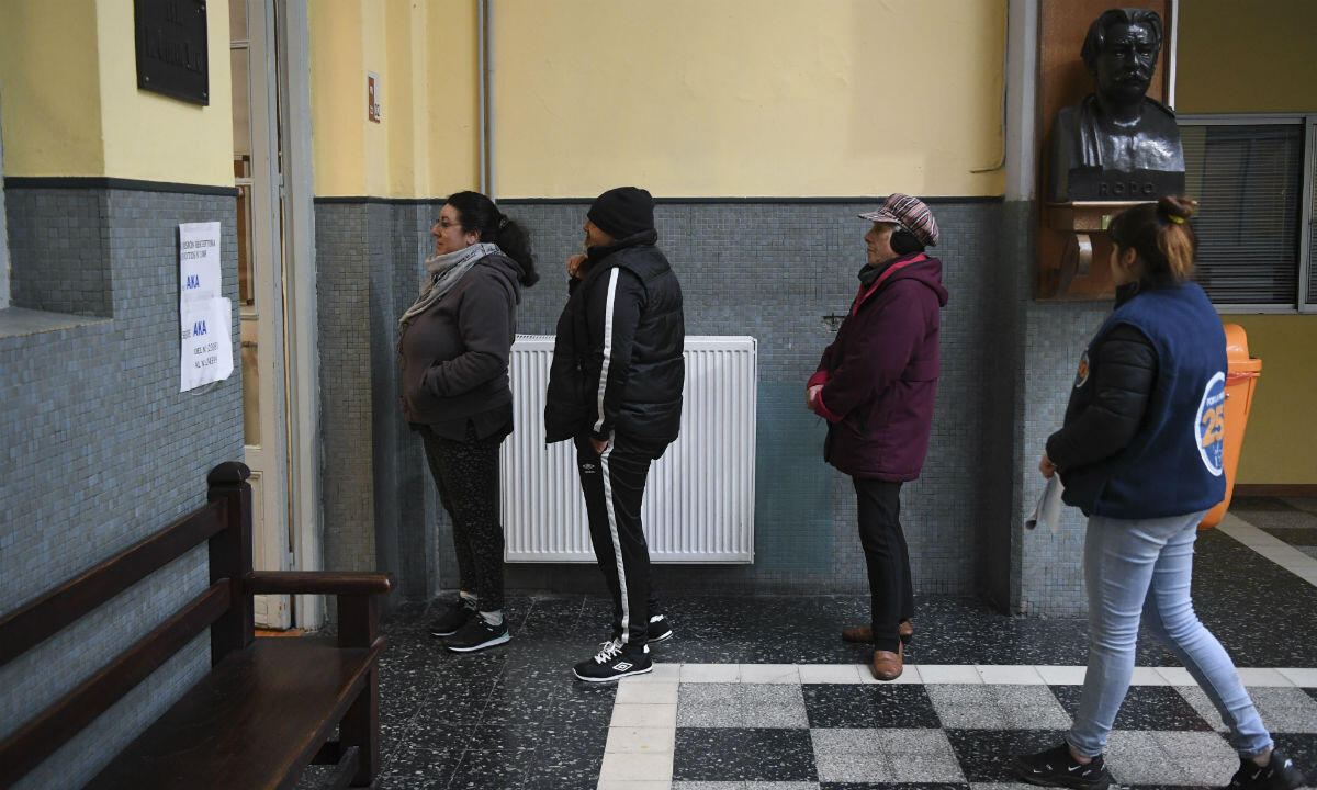 People line up to vote at a polling station during primary elections in Montevideo on June 30, 2019.