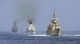 A French-made Lafayette-class frigate (centre) takes part in military exercises off the coast of Taiwan on September 17, 2014.