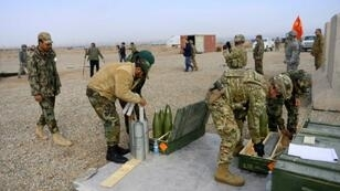 US, Italian and Afghan troops prepare shells during a February 2019 training exercise in Afghanistan's Herat province