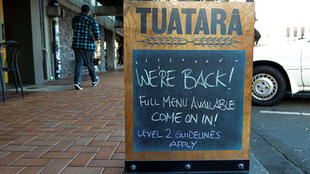 Bars across New Zealand reopened Thursday as the country emerges from a strict COVID-19 lockdown that began in late March