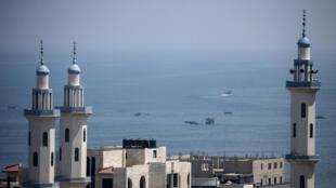 Palestinian fishermen take to the Mediterranean sea off Gaza City