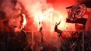 Ajax fans celebrate their team winning their 34th Dutch title on Wednesday