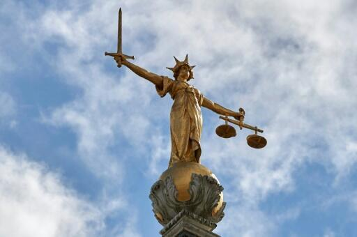 """The """"Lady of Justice"""" stands on the dome of the Central Criminal Court in London, commonly referred to as The Old Bailey."""