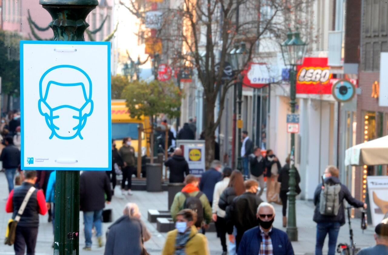 File - A sign recalling the mandatory use of protective masks in the city center of Duesseldorf, Germany, on November 10, 2020.