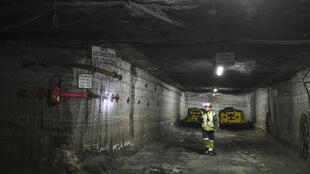An employee walks in a mining gallery of the Stocamine project in Wittelsheim, eastern France.