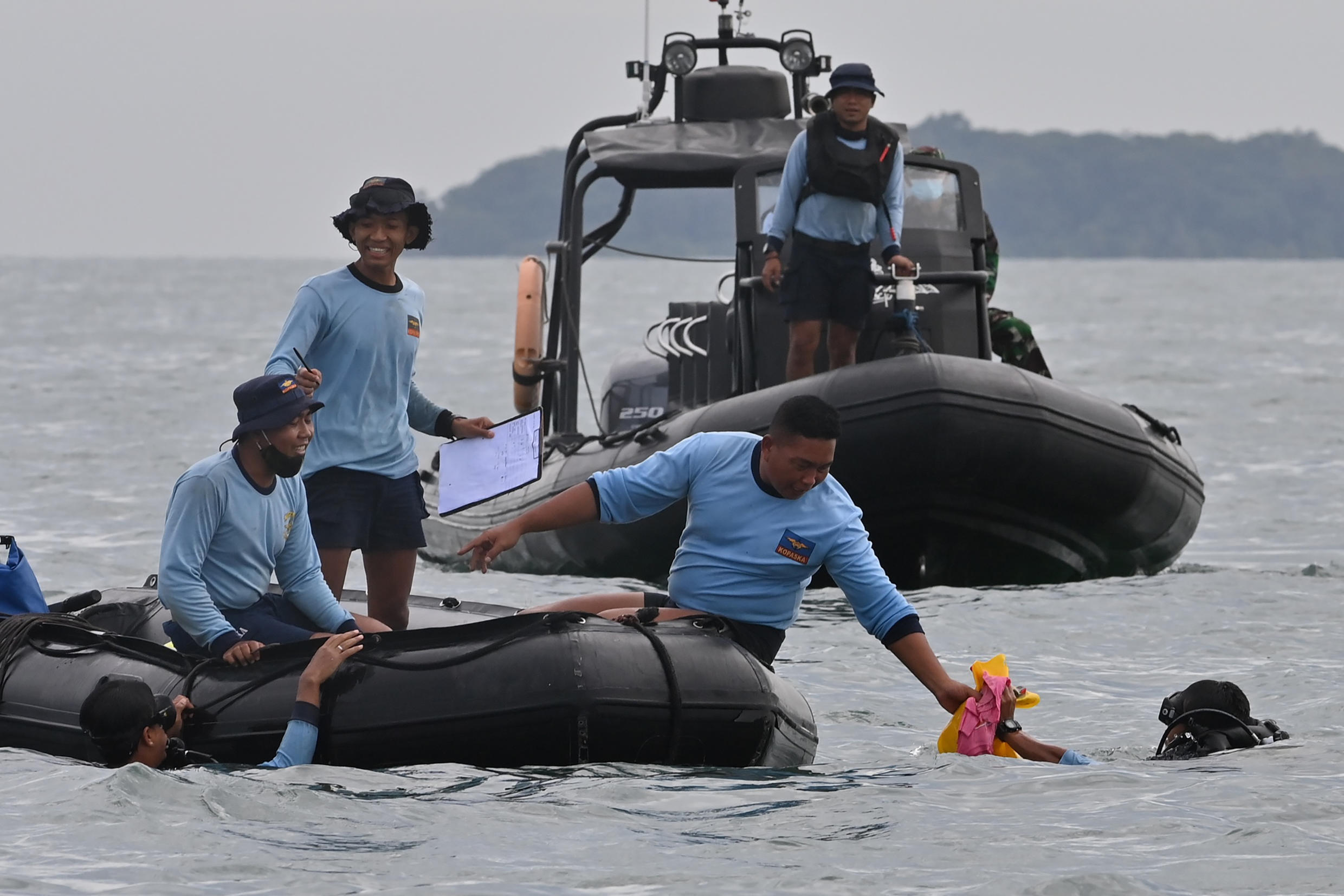 """Divers had been searching the Java Sea for the missing voice recorder -- one of the plane's two """"black boxes"""""""
