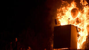 Bosnian Croats set fire to an effigy of the president of the International Criminal Tribunal for former Yugoslavia (ICTY)