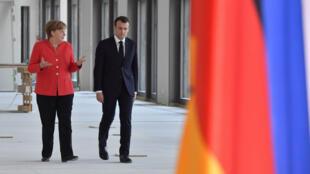 La chancelière allemande Angela Merkel et le président français Emmanuel Macron, lors d'une entrevue à Berlin, le 18 avril 2018.