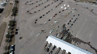 Cars line up to receive free cases of water after the city of Houston implemented a boil water advisory following an unprecedented winter storm, in an aerial photograph taken at Delmar Stadium in Houston, Texas, U.S., February 19, 2021.