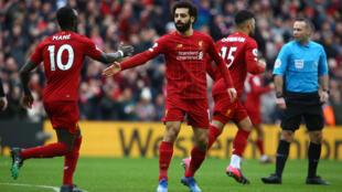 Liverpool, porté par ses stars  Sadio Mané et Mohamed Salah (c) buteur contre Bournemouth à Anfield, le 7 mars 2020, caracole en tête de la Premier League