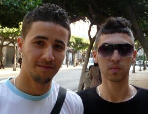 Algerian students Nabil (left) and Adil (right) puzzle over the lack of commemorations  of the historic Evian Accords.