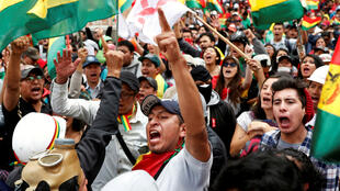 People shout slogans during a protest against Bolivia's President Evo Morales in La Paz, Bolivia, November 9, 2019.