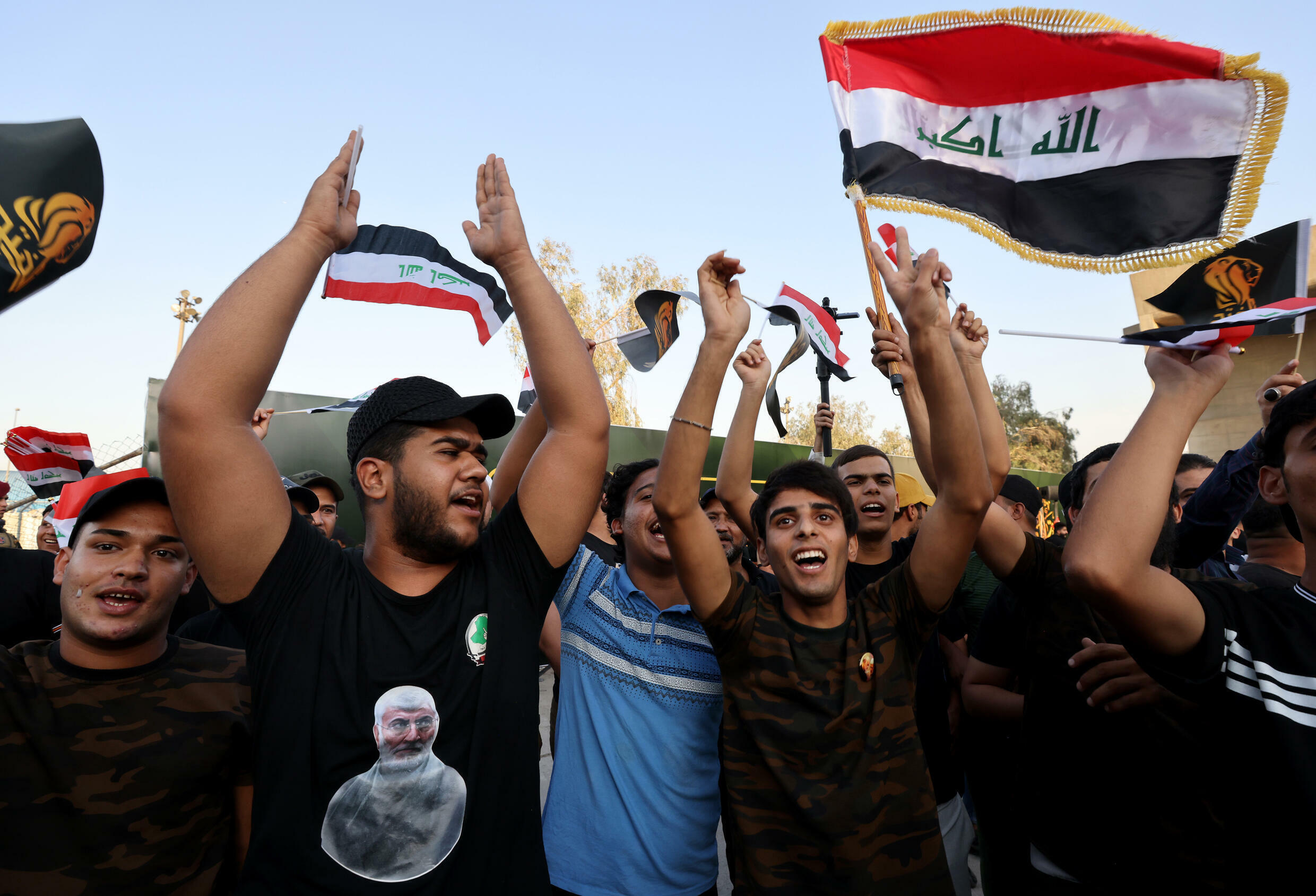 Supporters of the Iraqi Fatah alliance - which held the second largest bloc in parliament - attend election rally in Baghdad